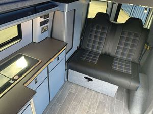 Seating and the kitchen area in the Camper conversions Brawbus
