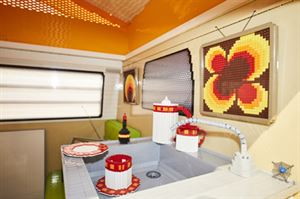 A complete camper van including sink, fridge and seat. photo credit: f.re.e / Messe München