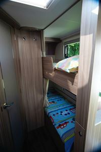 Bunks, each with a curtain, are in the nearside rear corner