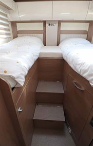 The Burstner Ixeo T 728 G rear bedroom with twin single beds