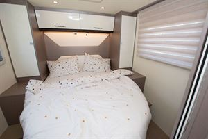 The double bed in the The Bürstner Lyseo TD 736 Harmony motorhome