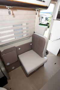 A seat by the habitation door in the The Bürstner Lyseo TD 736 Harmony motorhome