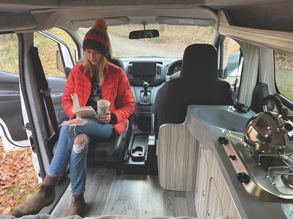 Reading in the CCCampers Clee campervan