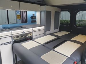 With seats folded down in the Calder Campers Renault Trafic Auto campervan