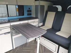 Dining table and seats in the Calder Campers Renault Trafic Auto campervan