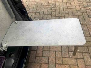 The modified campervan table can be clipped in place on the rear table support for outside dining - picture courtesy of Richard Phillips