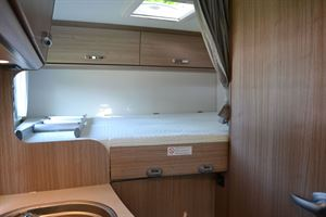 The transverse double bed in the Carado V132 motorhome