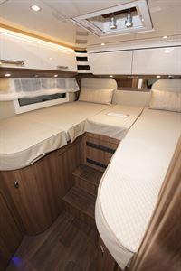 The rear bedroom in the Carthago E-line I 50 LE motorhome