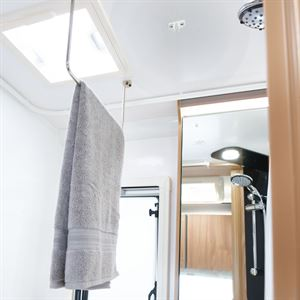 Ceiling mounted pull down hanging rail
