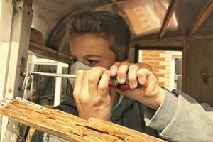 Lee's son Charlie tackles the task of window frame repairs