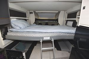 The second double bed, with ladder leading to it