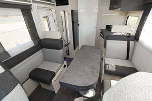 The interior of the Chausson 650 motorhome with travel seat showing
