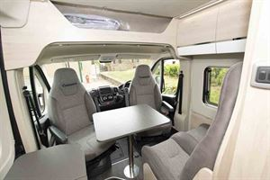 The cab, with seats swivelled around