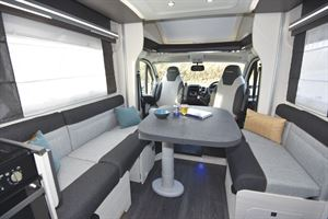 The lounge, with dining table, in the Chausson 520 motorhome