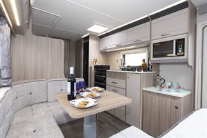 The dining area, near the kitchen, in the Coachman Acadia Xcel 830 caravan