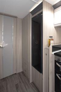 The stylish fridge freezer in the Coachman Acadia Xcel 830 caravan