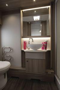 The washroom, with towel warmer, in the Coachman Acadia Xcel 830 caravan
