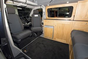 With cab seats turned to face the lounge area in the Rolling Homes Columbus S campervan