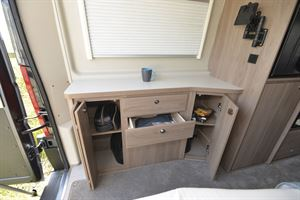 Useful cupboard storage in the Compass Avantgarde CV60 campervan