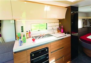 Convex-curved glossy white lockers distinguish Alpinas from all other caravans
