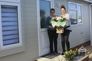 Debbie from Quickmove welcomes a customer to her new park home