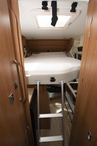 The drop-down bed at the front of the Dreamer Living Van campervan