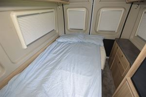 The bed in the Elddis Autoquest CV60 campervan