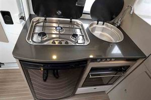 The kitchen includes a three-burner gas hob and a Thetford grill/oven