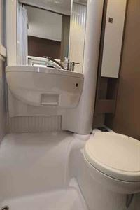 The washroom has a swivel cassette toilet