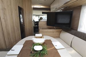 A view of the lounge, with the TV on display, in the Eura Mobil Integra Line 650 HS motorhome