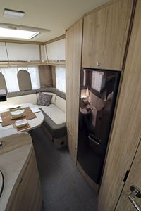 The rear lounge has a tall and slim fridge