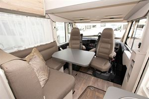 The lounge and cab in the Hymer Exsis i-580 motorhome