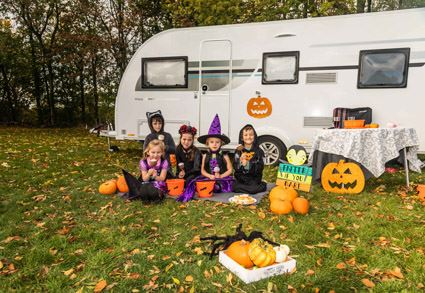 Camping and Caravan Club publishes list of campsites open in winter as well as those with festive speacial events like this Halloween one