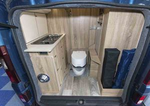 The rear of the campervan, with kitchen and toilet © Warners Group Publications, 2019