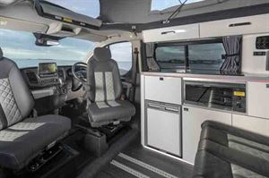 The kitchen has a two-burner gas hob, gas grill and fridge - picture courtesy of Lunar Campers