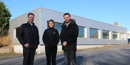 Neil Cox (right) with family co-directors Gaynor and Gavin at the former showroom site set to be redeveloped