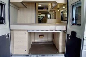 The rear doors open to show storage