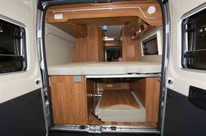 The rear of the motorhome, showing transverse bed and storage ©Warners Group Publications, 2019