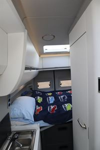 A view of the transverse bed in the Grand California 600 campervan