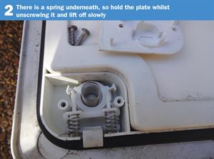 Motorhome Door Lock DIY 2: There is a spring underneath, so hold the plate whilst unscrewing it and lift off slowly