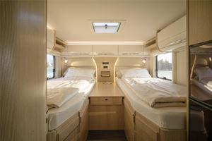 The rear twin single beds sit above a large garage
