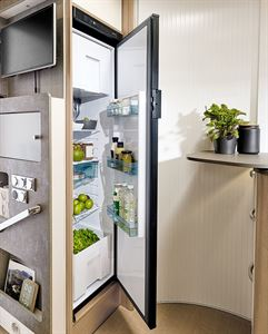 The kitchen is well-equipped and even has a full-sized fridge/freezer