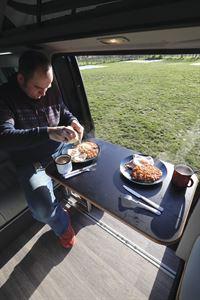 Enjoying breakfast in the HemBil Urban campervan