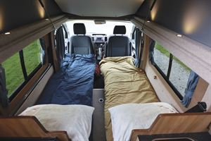With single beds made up in the Hillside Cromford campervan
