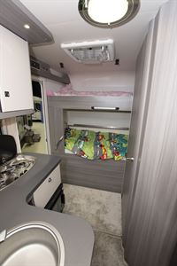 The bedroom in the Hobby Optima OnTour T65 HKM