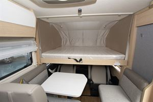 The drop down bed in the Hymer B-MC I 600 WhiteLine motorhome