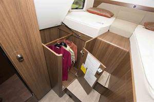 Handy wardrobe storage under the offside single bed