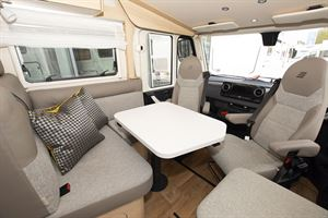The lounge and cab area in the Hymer B-MC I 600 WhiteLine motorhome