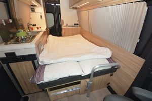 The fold down bed in the Hymer DuoCar S motorhome
