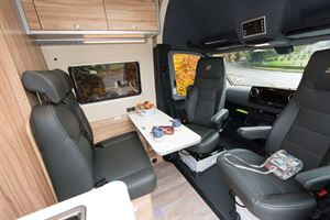 The lounge and cab in the Hymer Grand Canyon S
